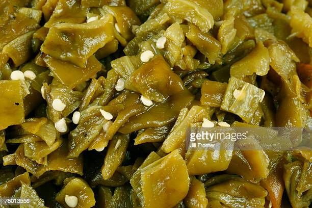 close up view of fresh hatch, new mexico green chile that has been roasted, peeled and chopped.  - green chili pepper stock pictures, royalty-free photos & images