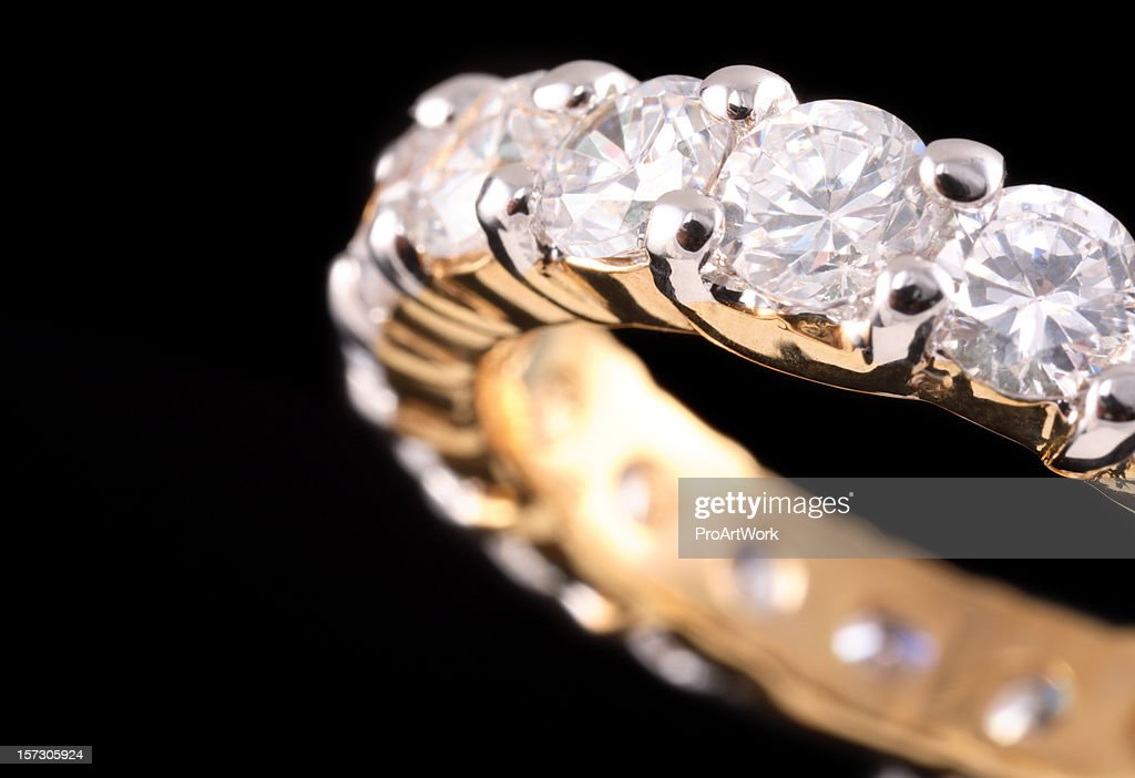 Close up view of gold ring with diamonds : Stock Photo