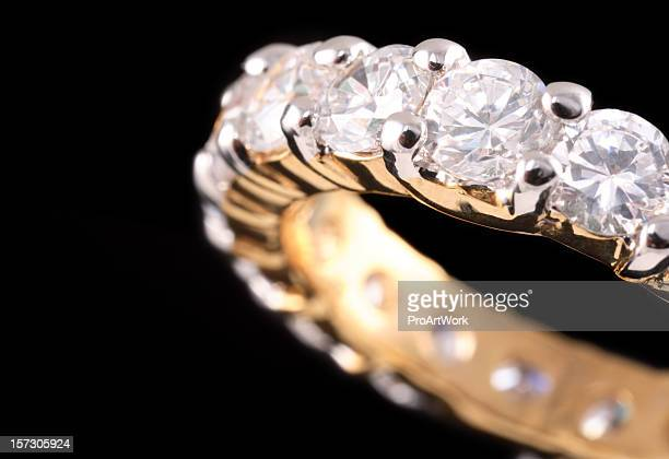 Close up view of gold ring with diamonds
