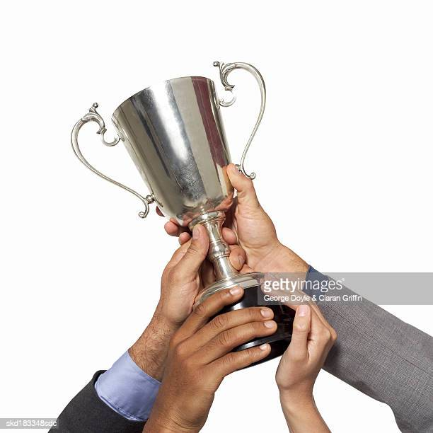 Close up view of hands holding a trophy