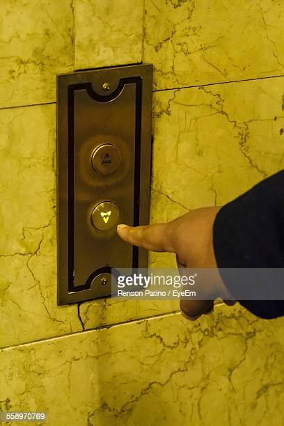 Close Up View Of Human Finger Pushing Elevator Button