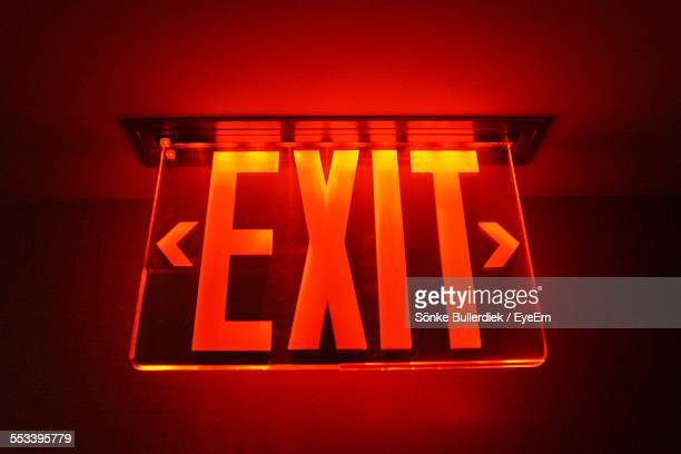 close up view of illuminated exit sign - exit sign stock pictures, royalty-free photos & images