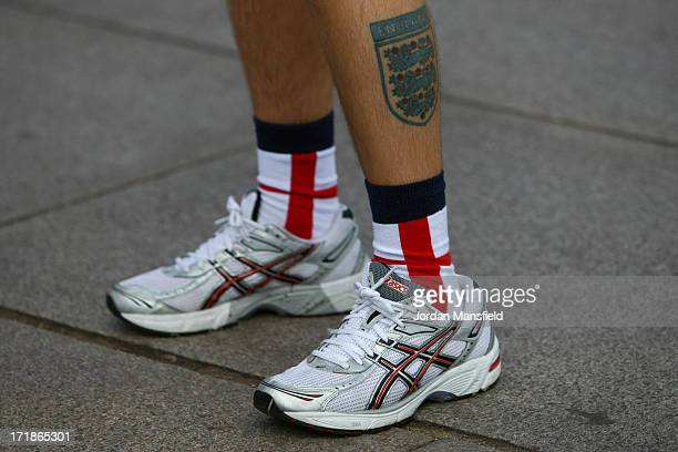A close up view of joint EDL leader Tommy Robinson's legs as he walks down The Mall on June 29 2013 in London England The leaders of the English...