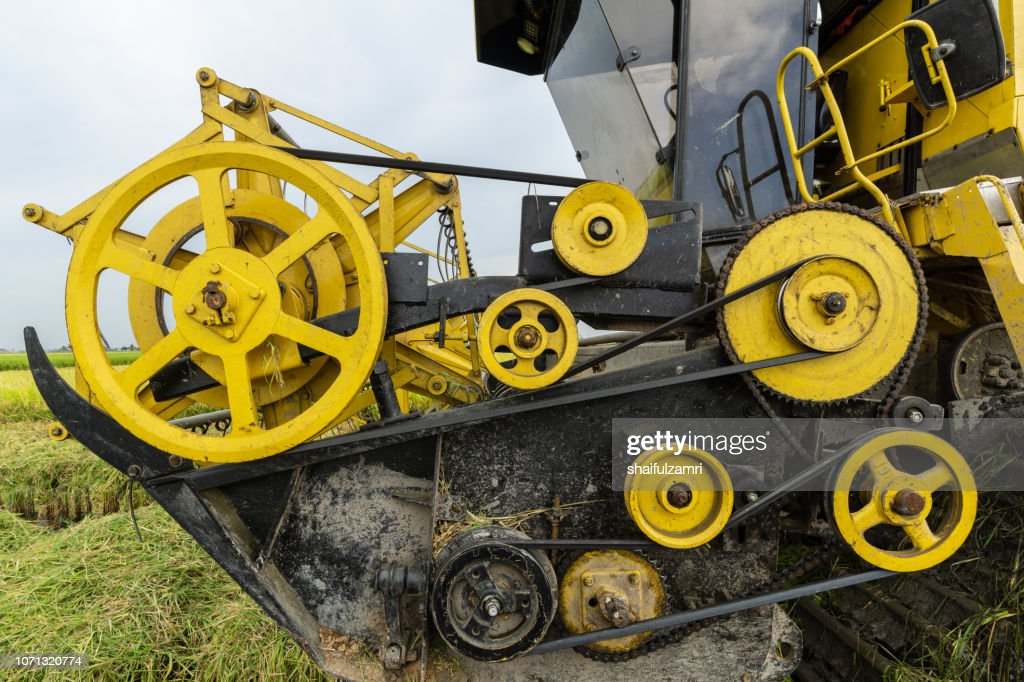 Close up view of machinery used for harvest paddy at rural area of Malaysia. : Stock Photo