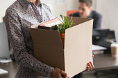 Close up view of new female employee intern holding box