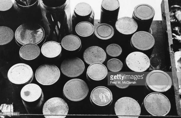 Close up view of paint bottles in Abstract artist Ad Reinhardt's studio New York New York March 1 1961