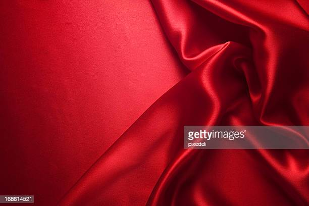 Close up view of red silk clothing piece and red background