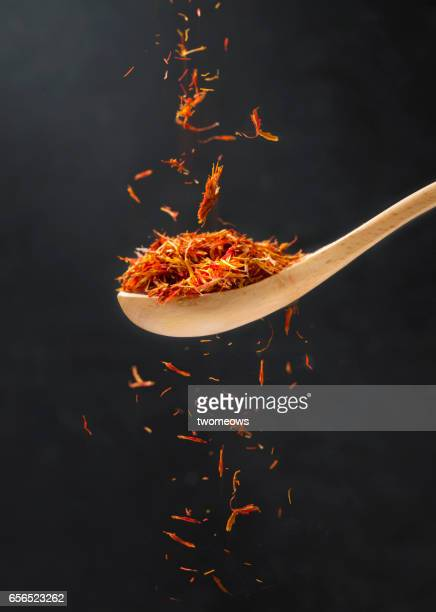 Close up view of saffron in wooden spoon.