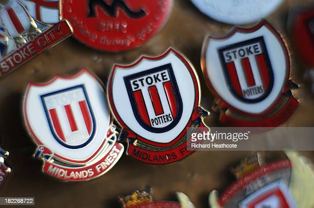 A close up view of Stoke City pin badges prior to the Barclays Premier League match between Stoke City and Norwich City at the Britannia Stadium on...