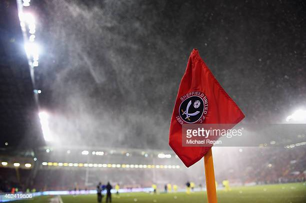 A close up view of the corner flag as snow falls prior to the Capital One Cup SemiFinal Second Leg match between Sheffield United and Tottenham...