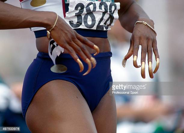 Close up view of the exceptionally long painted fingernails of United States track athlete Gail Devers as she prepares to compete in the Women's 100...