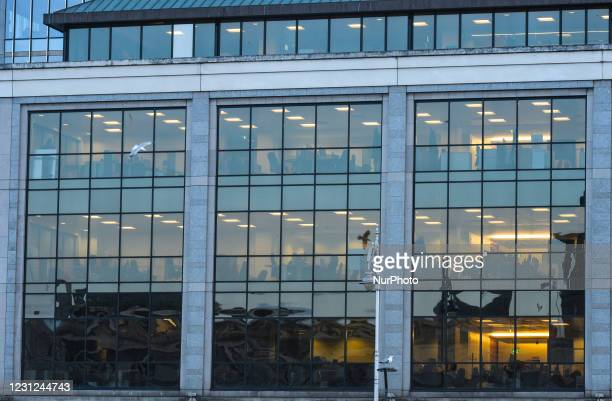 Close up view of the Ulster Bank Capital Markets bulding, on Georges Quay, in Dublin city center. People seen outside the Ulster Bank branch in...