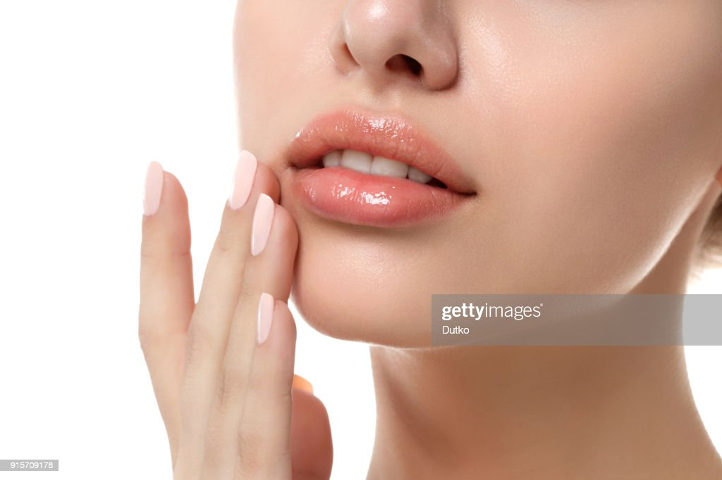 Close up view of young beautiful woman face : Stock Photo