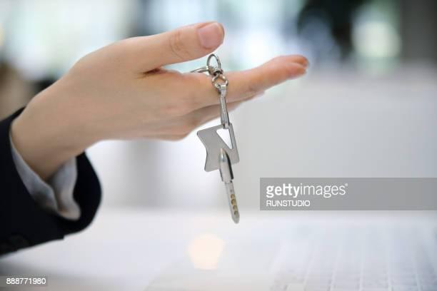 Close up woman holding key