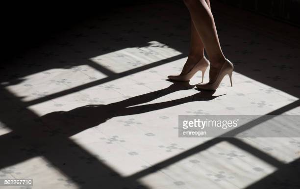 close up woman legs in high heels - light skin black woman stock photos and pictures