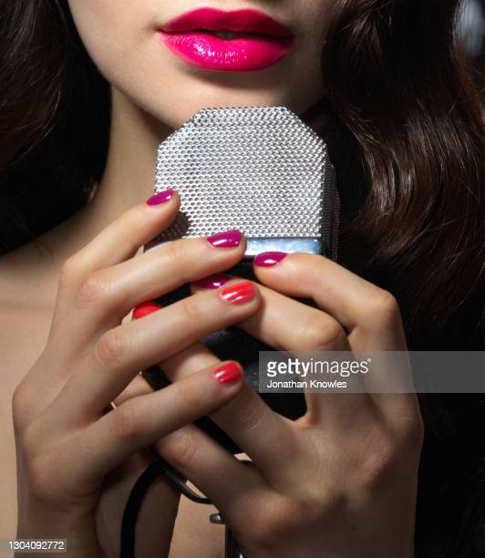 close up woman with retro microphone - pink lipstick stock pictures, royalty-free photos & images