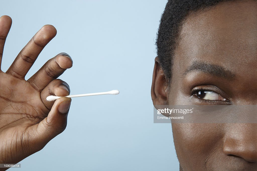 close up young man holding cotton bud : Stock Photo