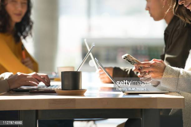 close up young people working on laptops in a modern space - wireless technology stock pictures, royalty-free photos & images