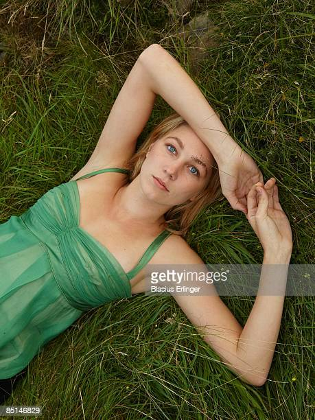 close up young woman in green dress grass  - green dress stock pictures, royalty-free photos & images