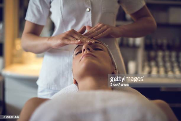 close up young women enjoying head massage - beautician stock pictures, royalty-free photos & images