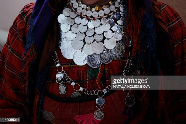 A close view of a coin necklace of a member of the singing group Buranovskiye Babushki at the local club in the village of Buranovo in the central...