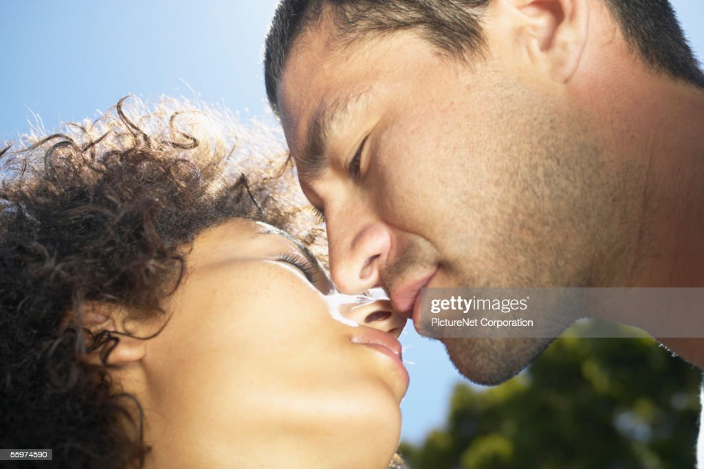 Close view of a couple about to kiss : Stock Photo