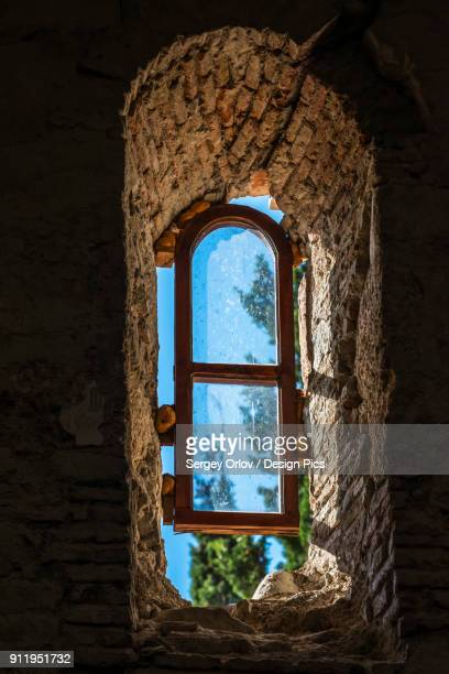 close view of a glass window in the ancient wall of ikalto monastery - 6th century bc stock photos and pictures