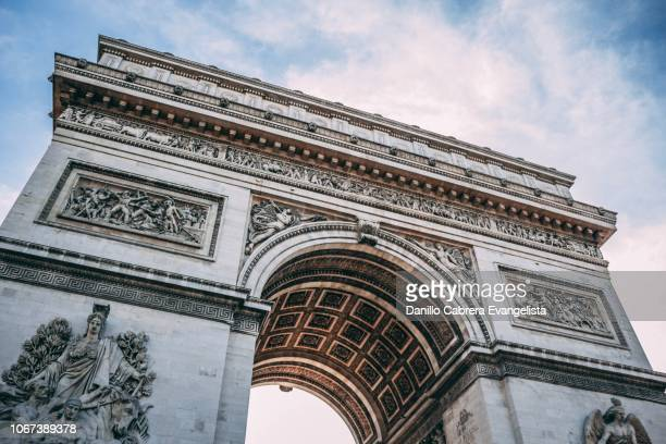 close view of arc de triomphe - triumphal arch stock photos and pictures