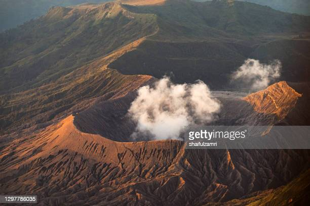 close view of bromo's active crater. mount bromo (2,329 meters) is an active volcano and part of the tengger massif, in east java, indonesia. - active volcano stock pictures, royalty-free photos & images
