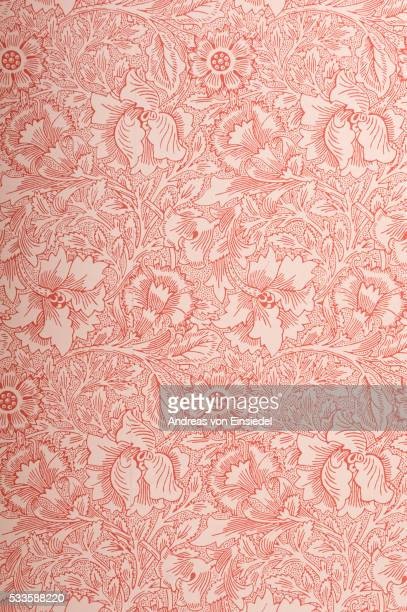 Close view of Poppy wallpaper by William Morris in the Business Room at Standen, West Sussex.