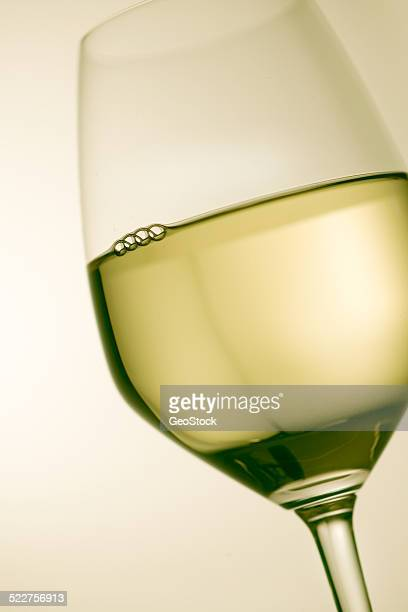 Close view of white wine in a glass