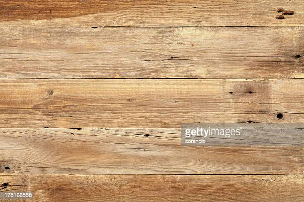 close view of wooden plank table - hout stockfoto's en -beelden