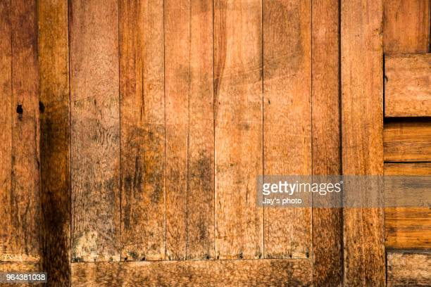close view of wooden plank table - floorboard stock photos and pictures
