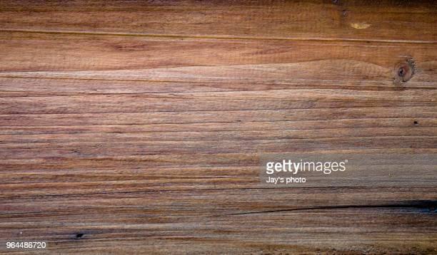 close view of wooden plank table - brown imagens e fotografias de stock