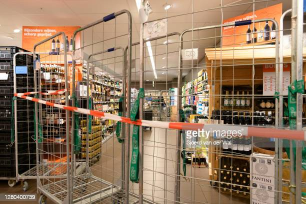 Closed alcoholic drinks section in a supermarket in the city center of Zwolle after the Dutch government announced new measures including the ban on...