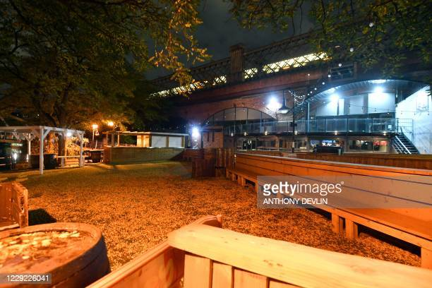 A closed bar is seen in Castlefield in Manchester city centre northwest England on October 22 2020 ahead of new coronavirus restrictions coming into...