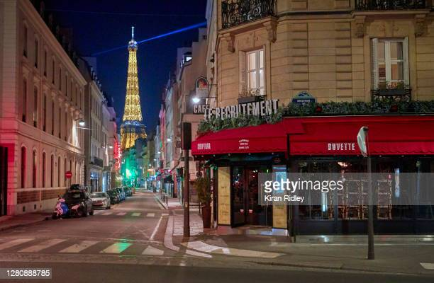 Closed bars and cafes are pictured on empty streets on the first night of the Coronavirus curfew on October 17, 2020 in Paris, France. The nightly...