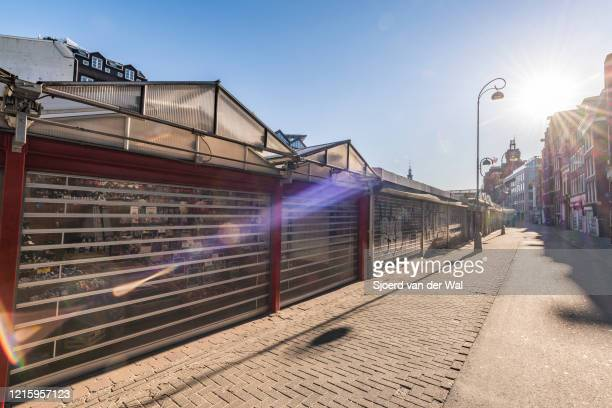Closed bloemenmarkt on the Singel canal in Amsterdam during a weekday morning following the advice of the Dutch government to stay at home for...