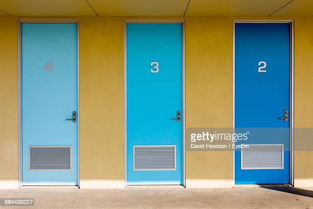 Closed Blue Doors With Numbers