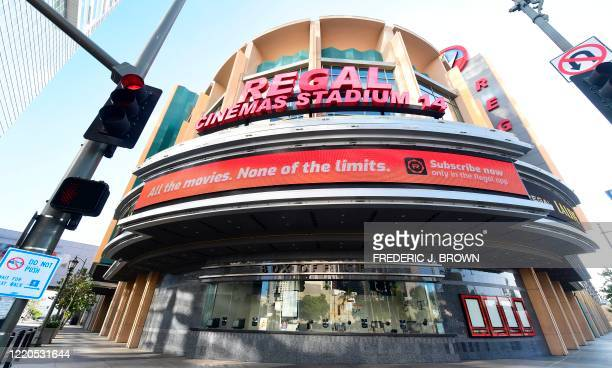 Closed box office is seen at a closed Regal Cinemas in Los Angeles, California on June 16 as much of the entertainment world has been shutdown since...