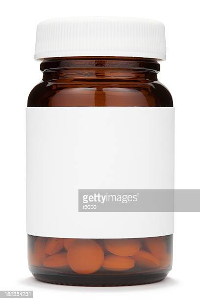 Closed brown glass jar with a blank label containing pills