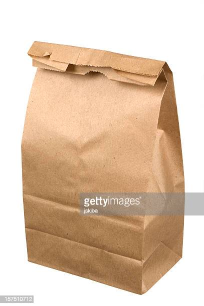 Closed brown paper lunch bag on white background