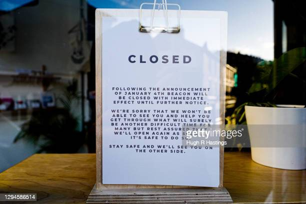 Closed cafe notice is displayed in a window on January 5, 2021 in Falmouth, United Kingdom. The British Prime Minister made a national television...