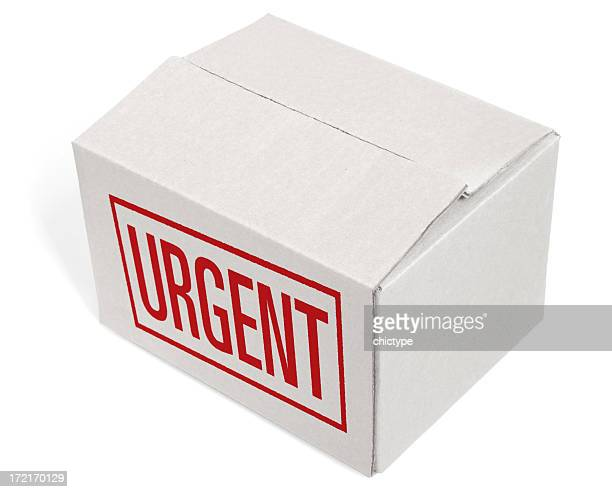 Closed Cardboard Box with an URGENT mention