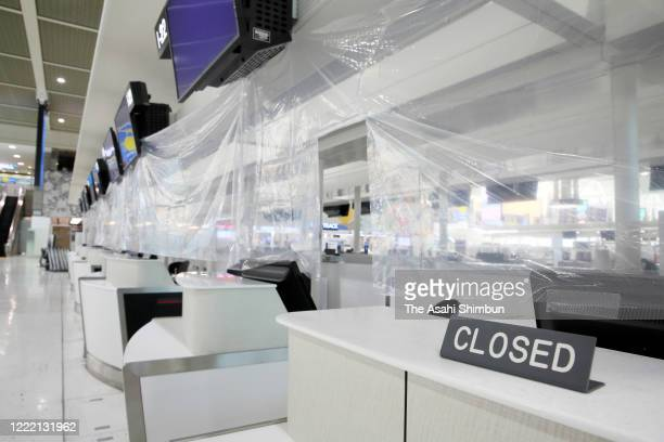 Closed check-in counter is seen at the Narita International Airport on the first day of so-called 'Golden Week' holiday week amid the coronavirus...