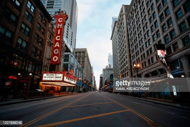 Closed Chicago Theatre is seen in Chicago, Illinois, on March 21, 2020. - Almost one billion people were confined to their homes worldwide Saturday...