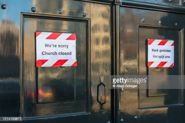 closed church in amsterdam netherlands because of coronavirus outbreak - church stock pictures, royalty-free photos & images