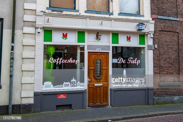 Closed coffeeshop after the Dutch government announced new measures for prevention of spreading of the Corona Covid-19 virus on March 16, 2020 in...