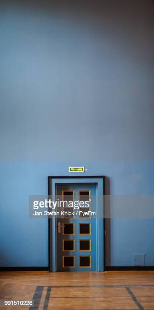 Closed Door By Blue Wall