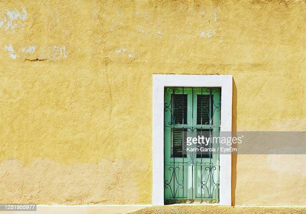 closed door, green and yellow, mexico - karin garcia eyeem stock pictures, royalty-free photos & images